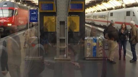 An einem Bahnhof warten viele Züge an Bahnsteigen, schemenhaft sind Passanten zu erkennen. (Foto: SWR, Symbolbild)