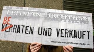 Lehman-Protestschild (Foto: picture-alliance / dpa, picture-alliance / dpa -)